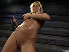 Lovely blondie lie on a couch touching her tits. She gets her smooth pussy drilled deep by the fucking machine.
