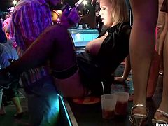Frisky curly bitch sits on a bar counter with her legs spread aside to get pounded in missionary style by rapacious dude, while other blond hussy rides a horny dude in reverse cowgirl style in insane group sex party by Tainster.