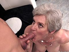 Sex addicted granny gives skillful blowjob to younger guy and gets her old pussy licked. After that she gets fucked hard on a sofa.