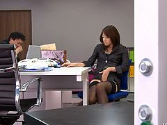Skanky black haired Japanese secretary Maki Hojo takes telephone calls and strokes her hungry pussy at the same time. Then she stimulates her hairy pussy with egg vibrator.