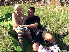 Kinky slim blond head with pale ass wears only bright stockings. Dirty-minded nympho has a strong desire to gain delight. Bitchie dick rider provides a lucky man with a footjob right on the rocks and desires to be analfucked tough for orgasm.