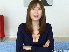 Japanese milf Yuma Asami is getting naughty with some dude in a bedroom. She rubs his prick ardently and licks it from time to time and seems to enjoy it very much.