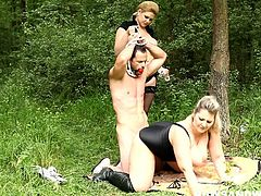 Hot BBWs Jitka and Dana ordered their sub to undress, tied him up, put him in the trunk of their car and drove him to the forest to torture his lusty cock outdoors. Apart from facesitting, whipping, gagging, testicles torture and ballbusting blowjob you will see the how these merciless BBW dominatrices open up their slave's tight ass for a strapon fucking.