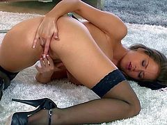 Emily Addison is a sexy bodied stunner with long legs and big melons. Sexy lady in black stockings and high heels shows it all as she fingers her snatch with big desire. Watch lonely Emily Addison have fun.