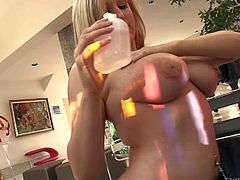 Topless big boobed blonde Dayna Vendetta in black thong and stockings shows off her tattooed booty before she turns black guy on with her wet massive melons. He plays with her juggs and then she takes his rod in her mouth.