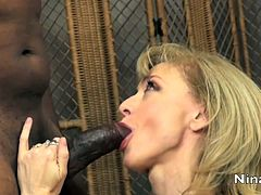 Blonde milf with huge tits loves riding black cock in sexy interracial hardcore