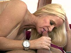 Blonde milf Totally Tabitha with juicy big boobs loves young hard cock so much. She seduces her step-son and takes his fat dick in her mouth. She bares her big breasts after cock sucking.
