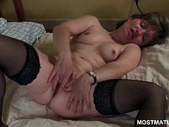 Shorthaired sweet mature in stockings fingering her soft cunt in close-up