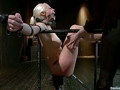 What a fucking horrifying scene this is! Lorelei Lee gets a lot of pleasant pain, being hooked up in her pussy and then arched with some chains.