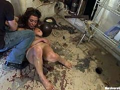 This girl gets enslaved by some guys. She lives in a basement. one time a day she gets fucked in her ass and pussy by several guys.