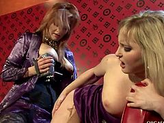Insatiable blond domina attaches didlo to her pussy in order to poke a steamy blond hussy in doggy pose through a hole in pantyhose in sizzling hot sex video by Tainster.