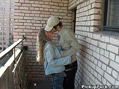 Curly young blonde sucks dick on the balcony