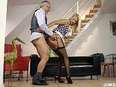Curvy light haired MILF Cherry Kiss looks hot in her black stockings. She blows one fat dick on her knees and then takes it for a long pussy ride.