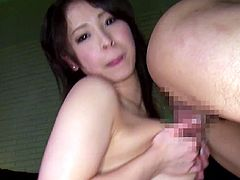 Big-breasted Japanese chick Minami Ayase is having fun with her man indoors. She sucks his dick devotedly and then favours the dude with a fantastic titjob.