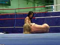 Kyra Black and Jessica Moore play really dirty in the wrestling ring and enjoy in hot and arousing lesbian wrestling session totally nude, getting their hands on each others pussy
