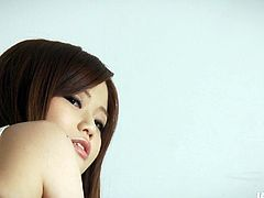 Playful Japanese teen Nao flashes her charms in lingerie