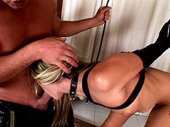Submissive blond whore in latex lingerie sits on the dirty toilet floor with her naked pussy while a pitiless master teases her clit with lash. Later he bandages and string her to the ceiling in order to get a zealous blowjob in BDSM involved DDF Network sex video.