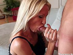 Lusty experienced Emma Star with slim sexy body and big firm tits in short black dress seduces young Sonny Hicks and gives him awesome blowjob on a lazy afternoon