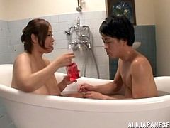 Well-endowed Japanese milf Reiko Yumeno is having fun with some guy in a bathroom. They take a bath together and the guy talks Reiko ito giving him a titjob.