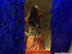 See a naughty Indian brunette stripping and flaunting her alluring body in this hot video provided by Bollywood Nudes.