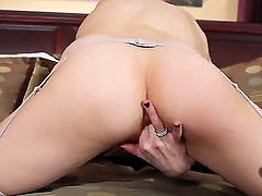 A gorgeous, pale brunette fingers her tight, pink pussy. And good news, fans of young, natural flesh and stocking fetishists alike will just adore this video. Truly a rare treat!