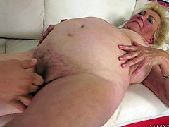 Sex addicted old bitch lies on the sofa. She gets her pussy fingered and toyed. Later on she gets fucked by younger guy.