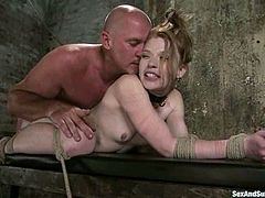 This severe torturer Mark Davis knows some amazing methods of suspending girls like Madison. He ties her legs and tugs them apart so that it'd be easy to play with her muff.