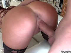 Red-haired hot milf Tiffany Mynx in stockings shows off her bubble butt and giant tits after she takes off her bra and panties. She gets her vagina pounded deep and hard doggy style!