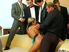 During the serious business negotiations, group of sex greedy businessmen seduce a fuckable office manager. They force her ride one of them in reverse cowigrl style while giving hand job and blowjob to two other daddies. Other dudes, in turn, enjoy steamy masturbation in peppering gangbang sex video by Tainster.