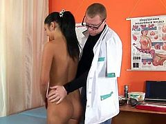 Make sure you check out this sexy brunette teenie visiting her gynecologist and spreading her legs to get her tight snatch examined!