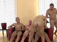 Black haired brunette nympho with heavy make up and long whorish nails fingers her shaved cunt with teasing and get on knees to suck many rock hard cannon in gang bang