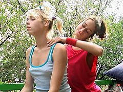 Young and skinny lesbian babes are having fun stimulating together in outdoor session