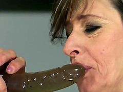 Brunette Judyt exposes her assets while getting tongue fucked by lesbian Nicole Sweet