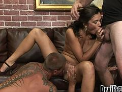 Gorgeous brunette blows two cocks switching from one to another. Later tattooed guy gets a hot blowjob from his friend. Wow! This wild bisexual orgy is insane! Now I've seen it all.