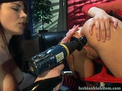 Messy brunette in red fishnet tank stands in doggy pose while a rapacious domina pokes her stretched asshole with a drill with a dildo on the end.