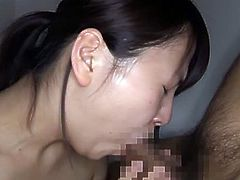 Pretty Japanese girl kneels in front of some guy and begins to suck his dick reluctantly. She soon manages to milk it dry in her mouth but doesn't enjoy it much.