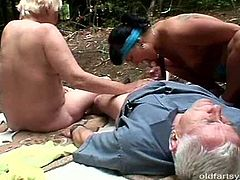 Two sporty grannies find a grey-haired grandpa resting on the blanket in forest. They approach him to give a head to his strain dick before they ride him in reverse cowgirl style in steamy threesome sex video by Pack of Porn.