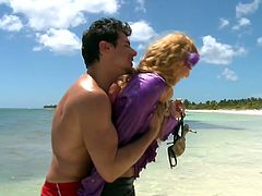 Nice and well curved blonde in satin blouse gives her boyfriend on the shore. After he drills her juicy tight slit in doggy style right on the sand.