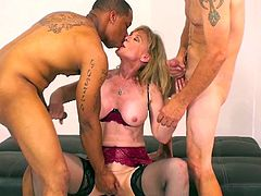 Busty blonde enjoys hardcore sex along two naughty hunks with large dicks