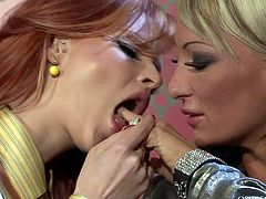 Two matures sluts (red-haired and blond) kiss each other in lips before one of them gets to aroused pussy of another hussy for a tongue fuck in doggy pose.