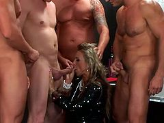 Bunch of aroused muscular dudes piss of ruined blond mature