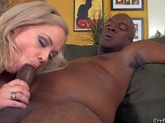 Katie Kox is a charming blondie with massive titties. She shows her killer juggs to her black step-daddy and then sucks his big beefy chocolate cock. Watch busty Katie Kox give interracial blowjob.