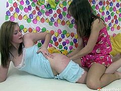 Two naive looking amateur chics play dirty lesbian games in bed. They suck lollipop before using it to rub hairy pussies and later draw images on each other's asses with chalk.