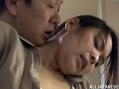 Naughty Japanese chick strips her clothes off and fondles her pussy. Then she sits down on a kitchen table and gets fucked.