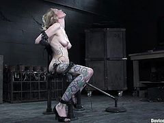 Take a look at this busty blonde's sexy body in this bondage video where she's tied up and masturbated until she cums all over.