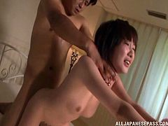 Hot Japanese in lingerie rides a dick and gets a facial