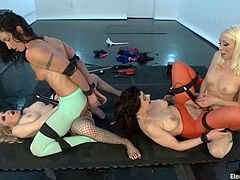 It's a crazy lesbian femdom foursome with two dominant vixens strapon fucking and toying two submissive ones.