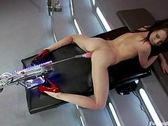 Beautiful dark-haired girl Aiden Ashley moves her legs behind her neck and gets her snatch pounded by an awesome fucking machine.