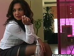Slut likes fingering her warm pussy and smoke in the same time