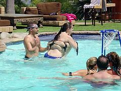 A large gathering of couples are at the mansion for some swinging. Before they switch partners to fuck the all have a giant game of basketball in the swimming area. Some couples get naked in the water and make out.